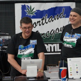 Treasurer Randy Quast and Director Russ Belville in new Portland NORML T-Shirts