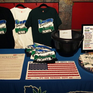 Portland NORML table with merchandise and literature.
